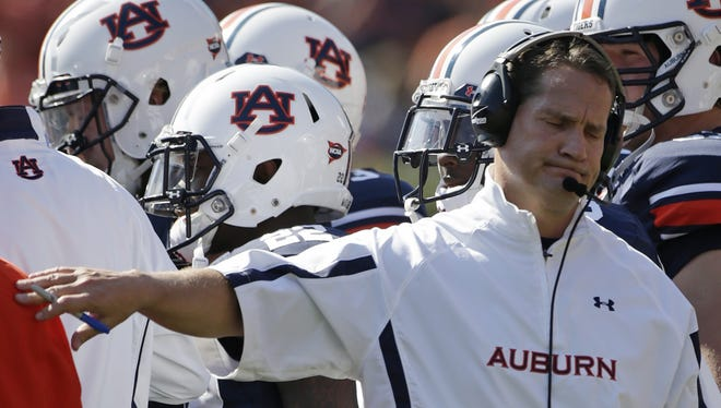 Auburn coach Gene Chizik reacts in the first half of an NCAA college football game against New Mexico State at Jordan-Hare Stadium in Auburn, Ala., Saturday, Nov. 3, 2012.