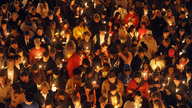 "A crowd participates in a candlelight vigil titled ""We Are One Mississippi"" at Ole Miss in Oxford last Wednesday. The event was in response to election-night protests that included some students shouting racial slurs."