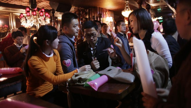 Singles in China using one of the biggest Chinese matchmaking websites in Shanghai on Nov. 11, 2012.