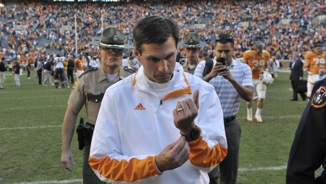 Tennessee coach Derek Dooley leaves the field Saturday after loosing to the Missouri Tigers 51-48 in quadruple overtime at Neyland Stadium. The Volunteers are 4-18 in SEC play under Dooley.
