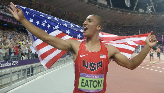 Ashton Eaton celebrates clinching the Olympic gold medal in the decathlon after running the 1,500 meters, Aug. 9 in London.