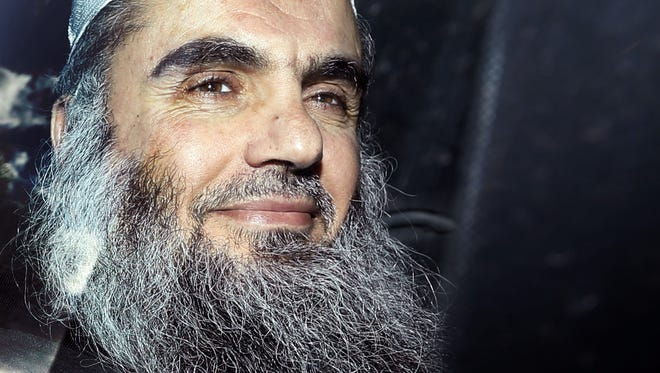Abu Qatada is driven away after being refused bail at a hearing at London's Special Immigration Appeals Commission in London on April 17.