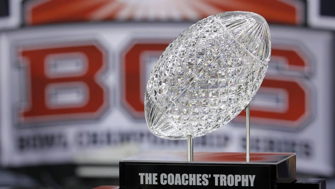 College presidents and league commissioners unanimously agreed to the structure of a four-team football playoff Monday during BCS meetings in Denver.