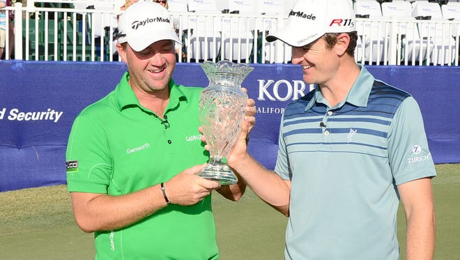 Peter Hanson, left, and Justin Rose celebrate their victory Monday in the Tyco Golf Skills Challenge at The Breakers in Palm Beach, FL.