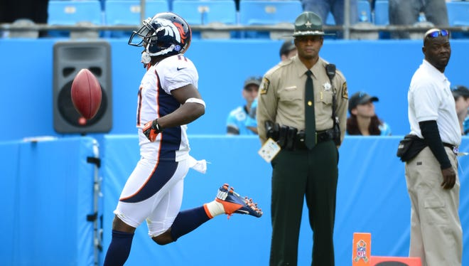 Broncos return man Trindon Holliday should've held onto the ball a bit longer during his punt return for a TD on Sunday in Charlotte.