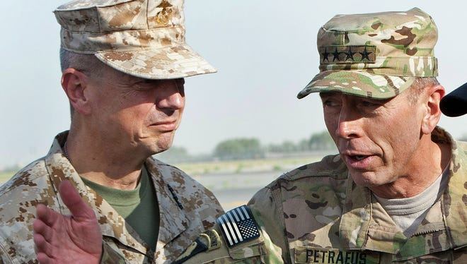Gen. John Allen, left, and David Petraeus are photographed in Kabul, Afghanistan, Saturday, July  9, 2011.