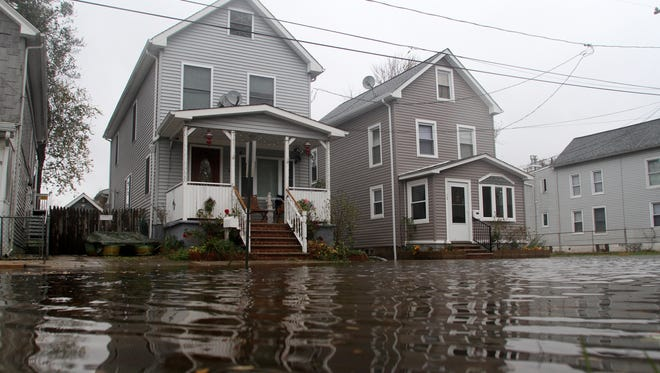 Floodwaters threaten homes in South River, N.J., hours before Superstorm Sandy even landed on Oct. 29.