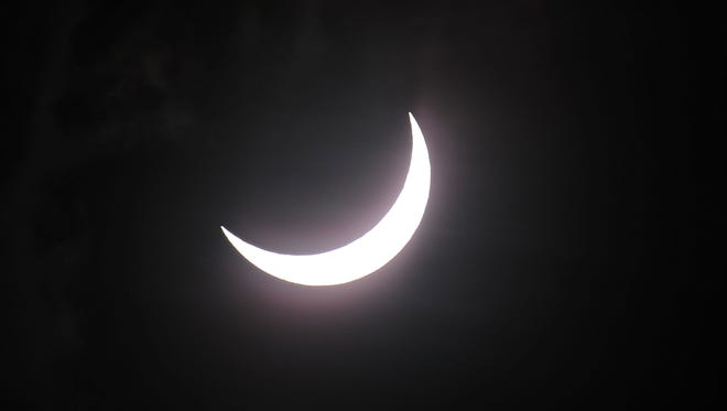 Near totality is seen during the solar eclipse in Palm Cove, Australia.