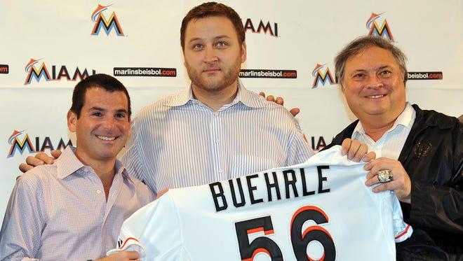 Marlins owner Jeffrey Loria (right) and president David P. Samson (left) introduced Mark Buehrle (center) last December.