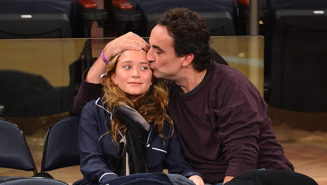 Mary-Kate Olsen and Olivier Sarkozy attend the Dallas Mavericks vs. New York Knicks game at Madison Square Garden on Nov. 9.