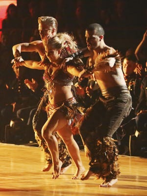 Derek Hough, Shawn Johnson and Mark Ballas perform in the Latin Trio round of Monday's 'DWTS.'