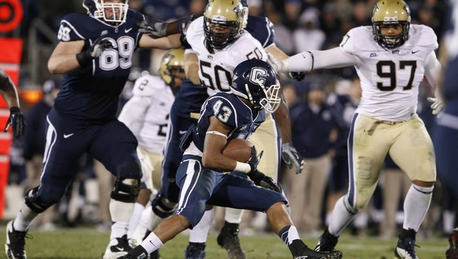 Connecticut running back Lyle McCombs runs the ball against Pittsburgh during a win on Nov. 9.