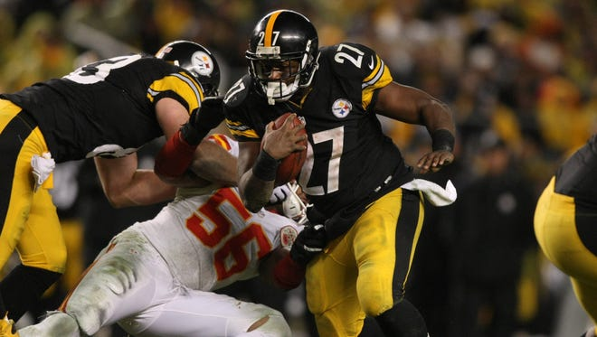 Steelers running back Jonathan Dwyer (27) runs the ball past Chiefs linebacker Derrick Johnson (56) during the second half at Heinz Field.