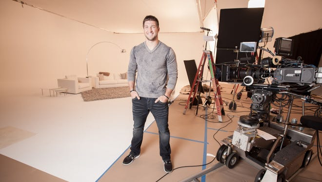 Jets quarterback Tim Tebow on a film set at Steiner Studios in Brooklyn. Tebow is the new spokesman for TiVo.
