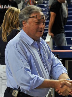 Miami owner Jeffrey Loria, left, shown here during an Aug. 14 game at Marlins Park, remained tight-lipped about about the Marlins' salary dump on the first day of the owners meetings.