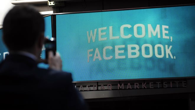 A sign welcomes Facebook at the NASDAQ stock exchange on its first day of trading, May 18, 2012.