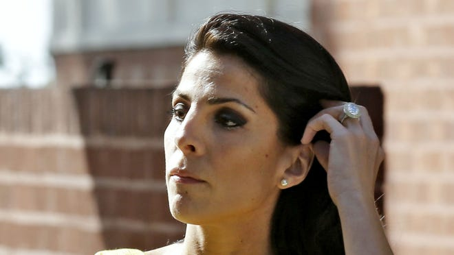 Jill Kelley leaves her home Monday in Tampa, Fla.