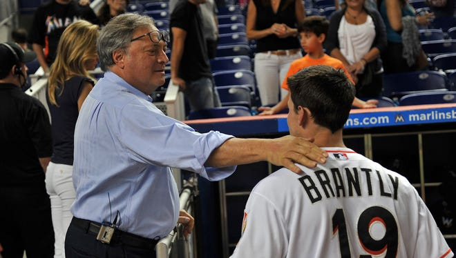 Marlins owner Jeffrey Loria, left, shown Aug. 14, has alienated his fan base, agents and others by trading most of the team's best players.