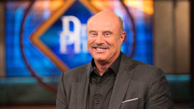 TV's Dr. Phil recently switched from a BlackBerry to an iPhone 4S, but says he misses typing on a physical keyboard.