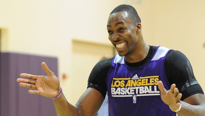 Los Angeles Lakers center Dwight Howard works out before the press conference to introduce new head coach Mike D'Antoni at the team's training facility in El Segundo.
