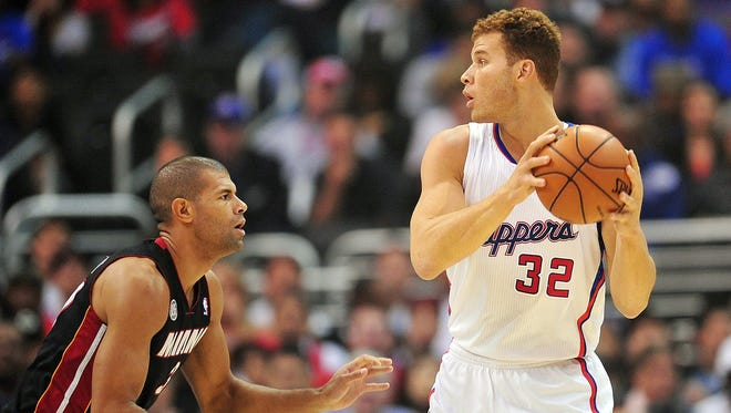 Los Angeles Clippers power forward Blake Griffin (32) controls the ball against the defense of Miami Heat small forward Shane Battier during the first half at Staples Center.