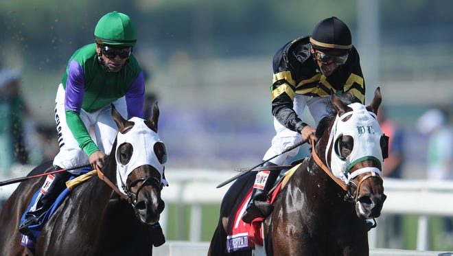Rajiv Maragh aboard Hightail, right, reacts after defeating Merit Man with Patrick Valenzuela in the 2012  Breeders' Cup Juvenile Sprint by a nose.