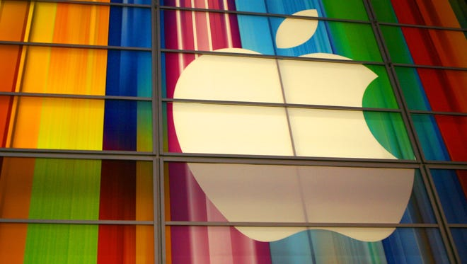Apple is realigning its executive ranks.
