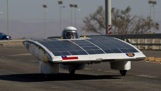 The driver of the Chilean team Das-Udec competes in the first stage of the Atacama Solar Challenge - a solar car race in Chile.
