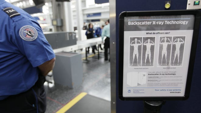 In this March 15, 2010, file photo, a sign describes the backscatter machines installed at O'Hare International Airport in Chicago.