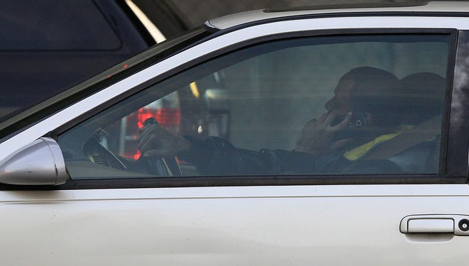 A driver uses a cellphone while in traffic in San Francisco.