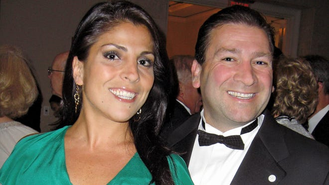 Jill Kelley, left, and her husband, Dr. Scott Kelley, pose for a photo in Tampa in 2011.