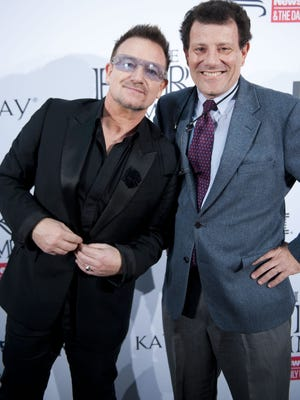 Bono poses with his hero, 'New York Times' columnist and Pulitzer Prize-winning journalist Nicholas Kristof at the 'Newsweek' & 'The Daily Beast' 2012 Hero Summit at the United States Institute of Peace on Nov. 14 in Washington.