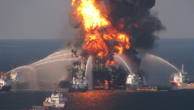Fire boats battle the blaze  aboard the Deepwater Horizon rig in 2010.