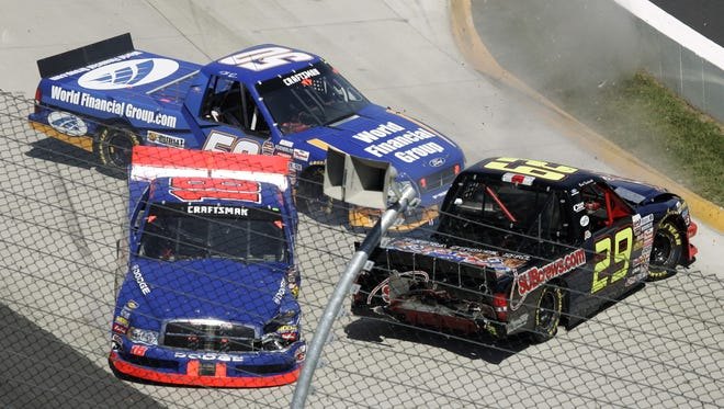 Brad Keselowski (29) spins out in front of Chase Montgomery, front left, and Todd Kluever at Martinsville Speedway in 2005.