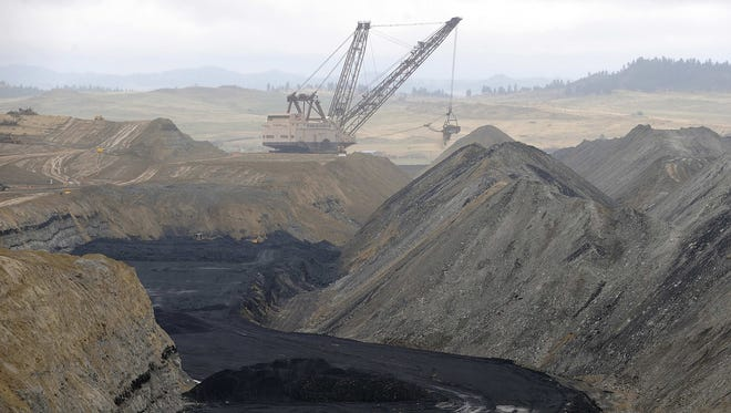 A crane operates at the Westmoreland coal mine northeast of Hardin, Mont., in May 2008.