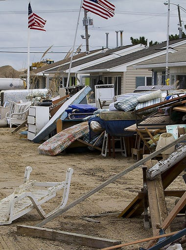 A road is filled with discarded furniture and debris on Nov. 14 in Ortley Beach, N.J. Residents finally got home to salvage belongings and clean up their homes after Hurricane Sandy struck their neighborhood.