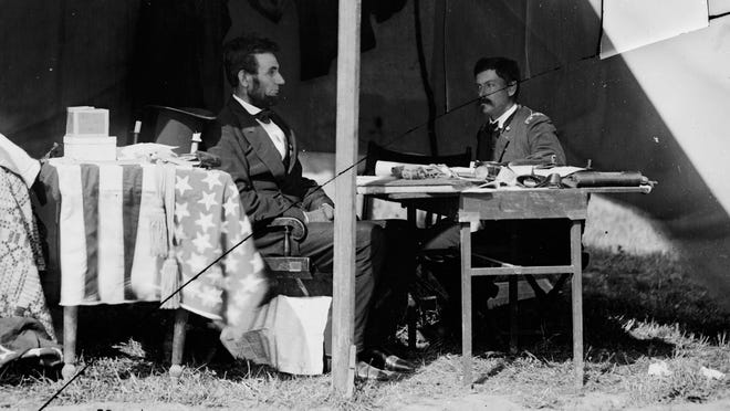 President Abraham Lincoln and Union Gen. George McClellan in the general's tent after the 1862 Battle of Antietam near Sharpsburg, Md.