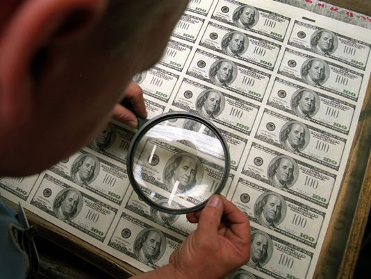 currency magnifying glass
