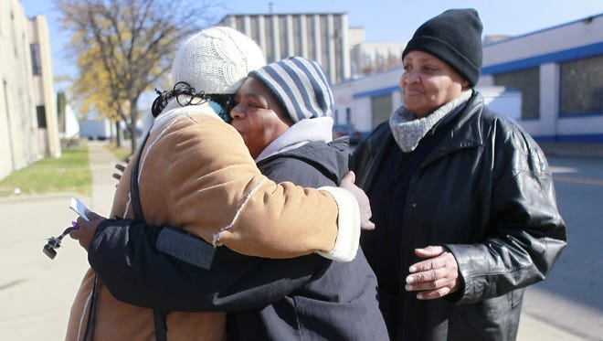 From left, Lynn Ward, Bernadine Moore and Gloria Nelson, embrace after leaving work for the last time outside the Butternut Bread facility in Cincinnati on Friday. Hostess Brands, makers of Butternut Bread, says it's going out of business.