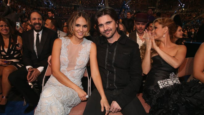 Juanes  and model Karen Martinez cuddle for a photo at the 2012 Latin Grammy Awards in Las Vegas.