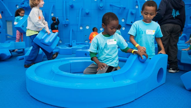 """Students from the Two Rivers Public Charter School play with Imagination Playground blocks Thursday in the exhibit """"Play Work Build"""" in Washington, D.C."""