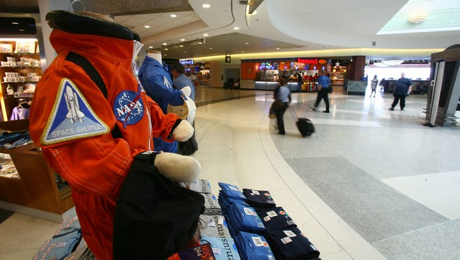 Travelers can purchase astronaut flight suits for their kids at the gift shop in Houston's William B. Hobby Airport.