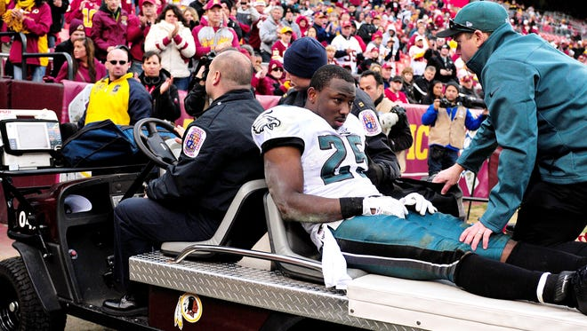 Philadelphia Eagles running back LeSean McCoy gets carted off the field in the fourth quarter against the Washington Redskins.