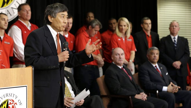 Flanked by Big Ten Commissioner Jim Delany, athletics director Kevin Anderson and others, University of Maryland President Wallace Loh (standing) explains the Terrapins' move from the ACC to the Big Ten.