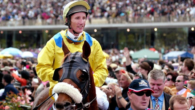 A 2002 file photo of Australian jockey Damien Oliver after winning the $1.8 million (USD) Melbourne Cup.