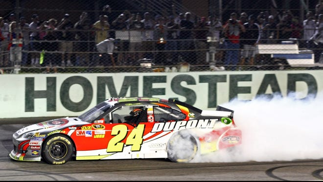 Jeff Gordon celebrates with a burnout after winning the Ford EcoBoost 400 at Homestead Miami Speedway.
