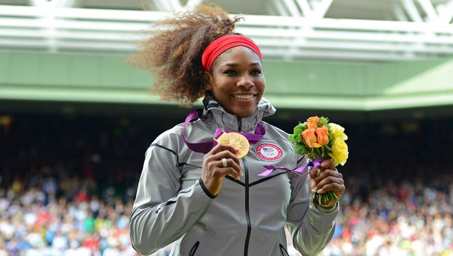 Serena Williams and her gold medal, step 2 in her huge summer.