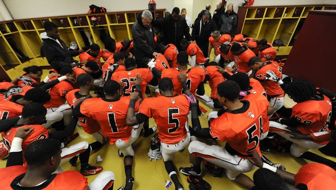 The Clairton High football team prepares to face Neshannock High last Wednesday, a game the Bears would win for their 59th in a row, the longest winning streak in the nation.