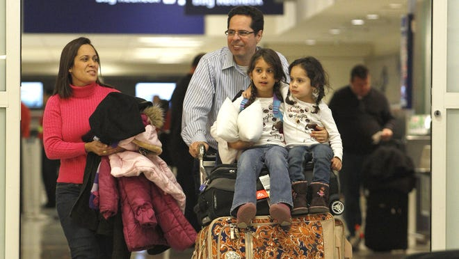 Leaving plenty of time to clear security or maneuver through traffic, and keeping essentials handy are two tactics for minimizing the stress of family travel on busy days.