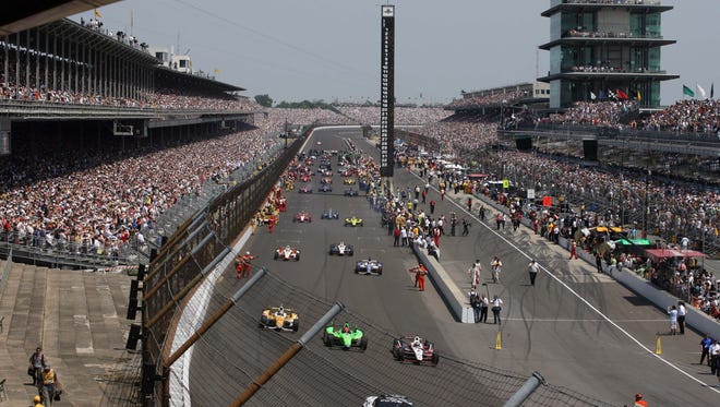 Ryan Briscoe leads the field as they leave the grid for the start of the 2012 Indianapolis 500 at the Indianapolis Motor Speedway.